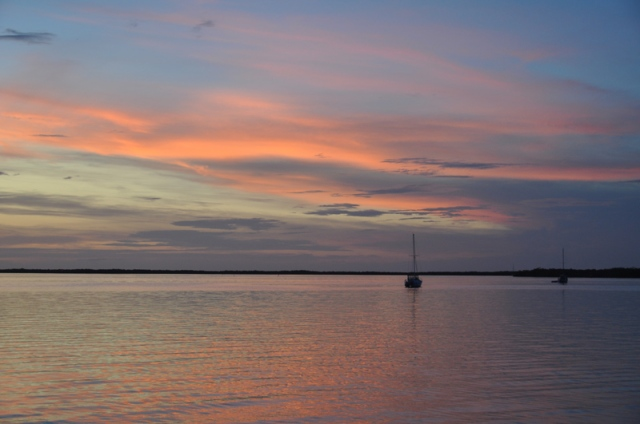 #3 – another very tranquil scene, but with such lovely colors. I love how the wispy color flows across the sky to be reflected in the water below. Again, there are the boats to add to the stillness of the evening.