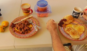 Breakfast on the patio - tortillas, beans, salsa, papaya, mangoes, coffee. Joel had pancakes.
