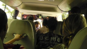 The bus back to David was crowded, sometimes standing room only! You can see here that one person was evening sitting backwards on the engine next to the driver. The bus had to pass some people flagging it down because there was no room.