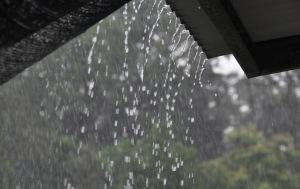 Rain cascades off the roof