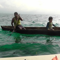 This Indian woman paddled her dugout canoe with her home made paddle over to the water taxi.