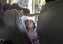 Beautiful sleeping child on the bus with her dad and brother.