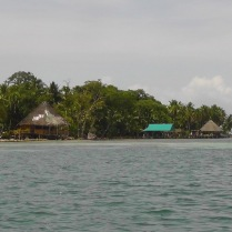 After lunch we got a water taxi and headed out across the water. The closer place with the thatched roof is where we stopped later on.