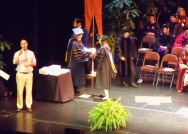 Elizabeth makes her way across the stage, receiving congratulations along the way.