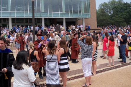 After the ceremony, the crowd gathers in the courtyard where family and friends can look for their graduates.