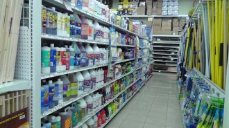 The cleaning aisle with about any cleaning product you could imagine, as well as mops, brooms, sponges and brushes.