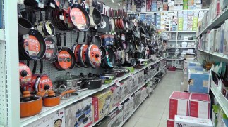 Pots and pans, kitchen gadgets, dishes on the right. They have a very good selection of small appliances and all sorts of kitchen items.