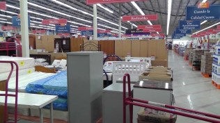 Mattresses, beds, wardrobes. Here I was standing at the back of the store, the little kitchen behind me, the doors on the right. This gives you some idea how far it is to the front of the store.