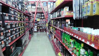 One aisle of the car department - wiper blades, wax, cleaning products, etc. and tool boxes on the left. There are two more aisles of car related items as well.