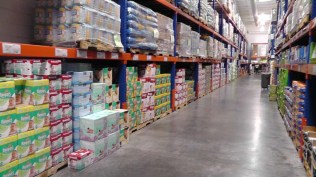 Along the back wall, lots of diapers, paper goods, and cleaning supplies