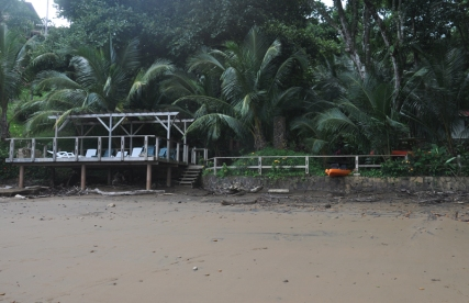 The beach sitting area, and the kayak we took out earlier in the day.