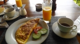 Omelet, and fresh squeezed orange juice.