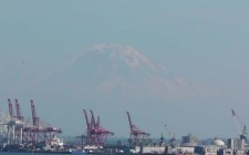 Mount Rainier behind the shipping cranes as we leave port.
