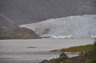 Kayakers paddle to the glacier for a closer look.