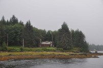 The Indian lodge with the totems out front. This is only accessible by boat.