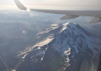 We flew over Mount Rainier, which is so high that it looked very close to the plane!