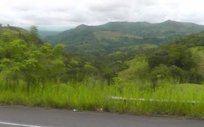 The bus proceeded through lush, green countryside with the beautiful mountains in the background.