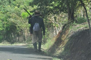 Another man with his machete and work tools.
