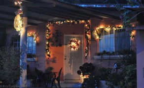 Ribbons and garlands are used outdoors on many houses.