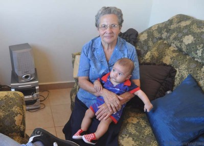 Yaira's little boy on the lap of his maternal great grandmother.