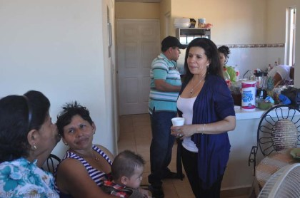 Yaira's mother (seated, striped blouse) talking with her sisters, Yaira's aunts.