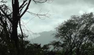 I see the clouds clear to reveal a peek at Volcan Baru.