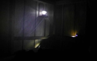 The lantern and my headlamp glow through the mosquito netting over the bed.