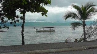 More of the beach scene from our lunch table. It looks like it's raining a bit across the bay.