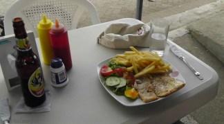 Joel's lunch, baked garlic fish, good stuff!
