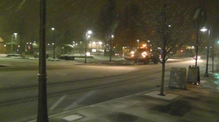 A snowplow starts making the rounds.