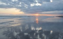 I love the reflections of the sky on the wet sand.