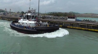 The tug moves on ahead of us. We were told that it has 6000 horsepower, and can move as quickly sideways as forward.