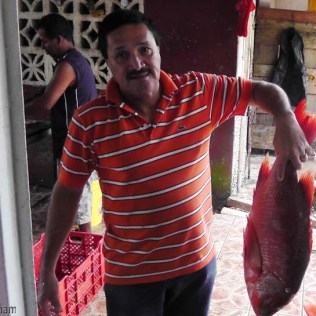 The man says I need this big pargo (red snapper)! He's right, and I bought it.