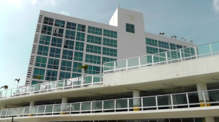The outside of the hotel is bright and pretty. The garage is on the second level, and the pool is on the 3rd level.