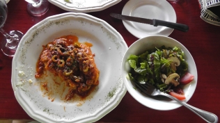 Corvino in a tomato sauce with green olives, and salad on the side.