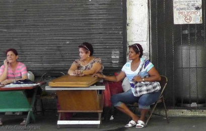 Three ladies - I think they were selling lottery tickets.