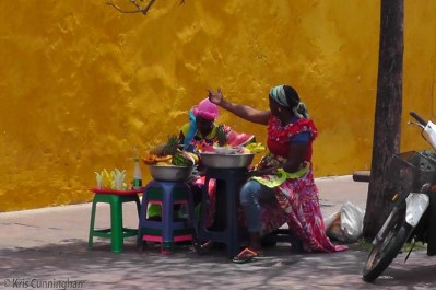 These colorful women were selling fruit at the entrance of the historical district.