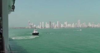 The tug follows us into port.