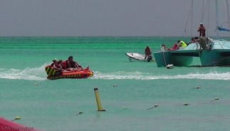 Inflatable sofas were being dragged behind other boats.