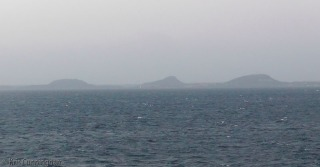 Leaving the area, the island turning gray in the distance.