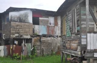 These are occupied houses. The one on the right has some interesting painting on the outside.