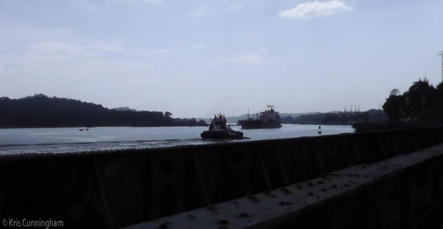 As we leave, a tug makes its way north as a ship comes south.