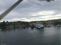 We are airborne, leaving the town, the ferry, and the boats behind.