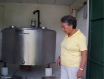 Cedo checks the milk storage tank at her farm.