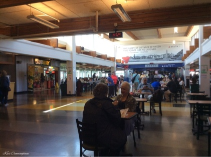 The ferry terminal has lots of places to eat and sit.