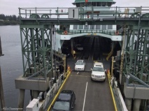 The vehicles make their way off the ferry.