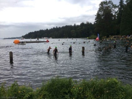 The event started at 6:30 AM! Some of the participants are getting a feel for the water while the first wave of competitors lines up farther away. Each category had different colored caps and left in groups 10 minutes apart, so after a while there were swimmers everywhere. There were two races, the Olympic which went first, and then the sprint which was for shorter distances.