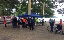 There is a crowd gathering at the results tent, but no results until they make sure the computers recorded everything correctly. Everyone has a computer chip so their times are recorded at various points and at the finish.
