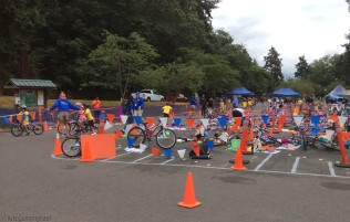 Some of the bikes are coming back in and the kids are heading out for the run, while others are finishing the swim and getting on their bikes.