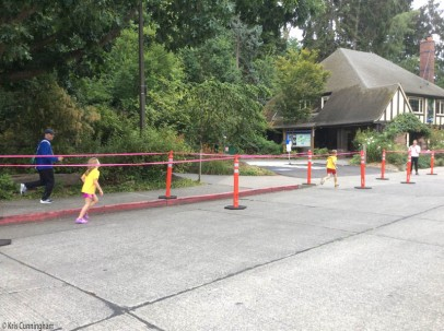 Kids are running the last part of the race, sometimes with parents running along outside the fence.